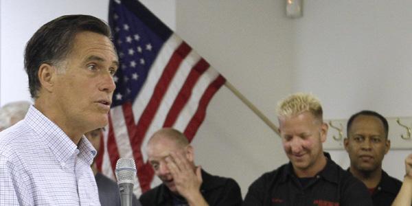 Romney holding microphone - Jim Cole AP - banner.jpg
