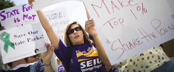 SEIU sign holder - Max Whittaker : Reuters - banner.jpg