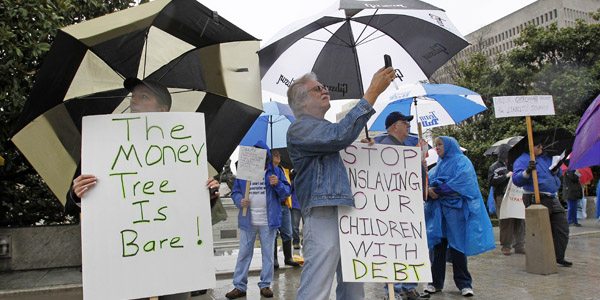 Tea party umbrellas - AP Mark Humphrey - banner.jpg