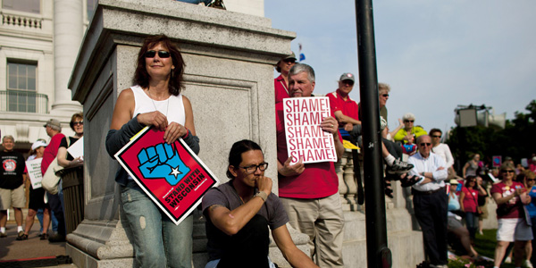 Wisconsin protesters on steps - Darren Hauck Reuters - banner.jpg