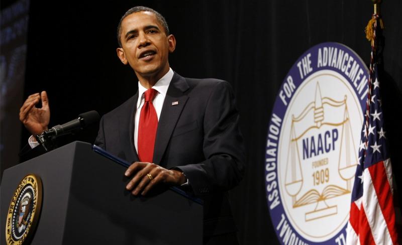 obamaNAACP.banner.reuters.jpg.jpg
