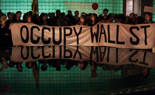occupygreen.banner.reuters.jpg.jpg