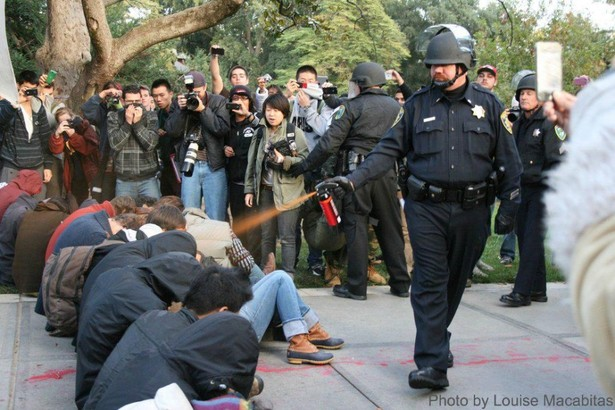 192897-us-davis-police-lt-john-pike-dousing-seated-students-with-pepper-spray.jpg