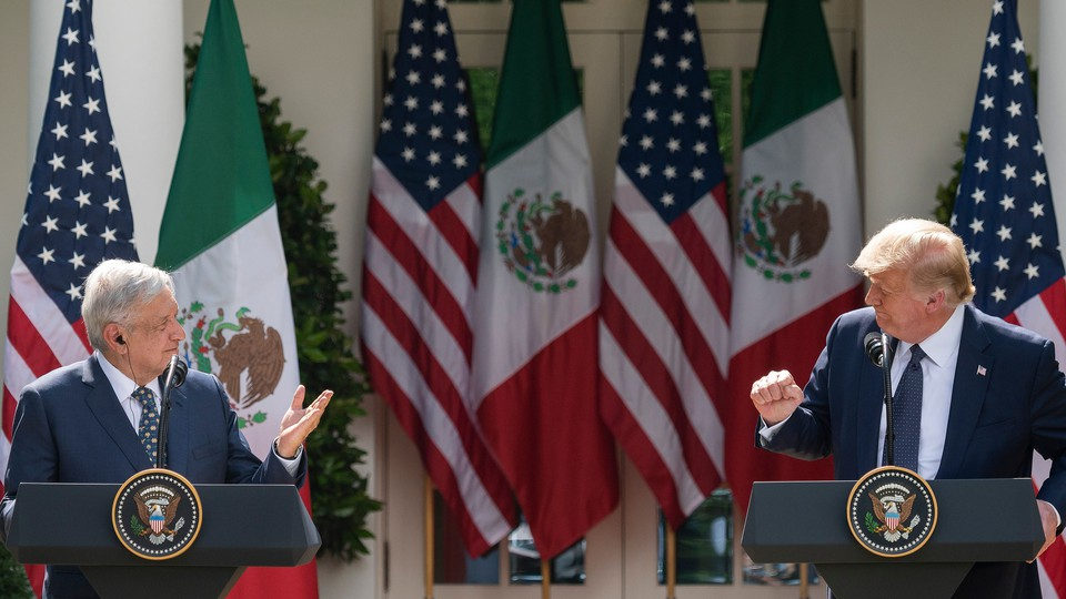 Donald Trump and Mexican President Andres Manuel Lopez Obrador speak at a joint press conference in the Rose Garden of the White House in July 2020.