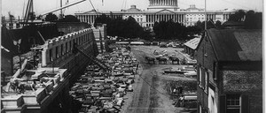 The Library of Congress under construction and the U.S. Capitol