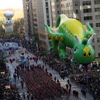 Giant balloons depicting the Pillsboury Dough Boy and Rex The Happy Dragon fly through Macy's Thanksgiving Day Parade.