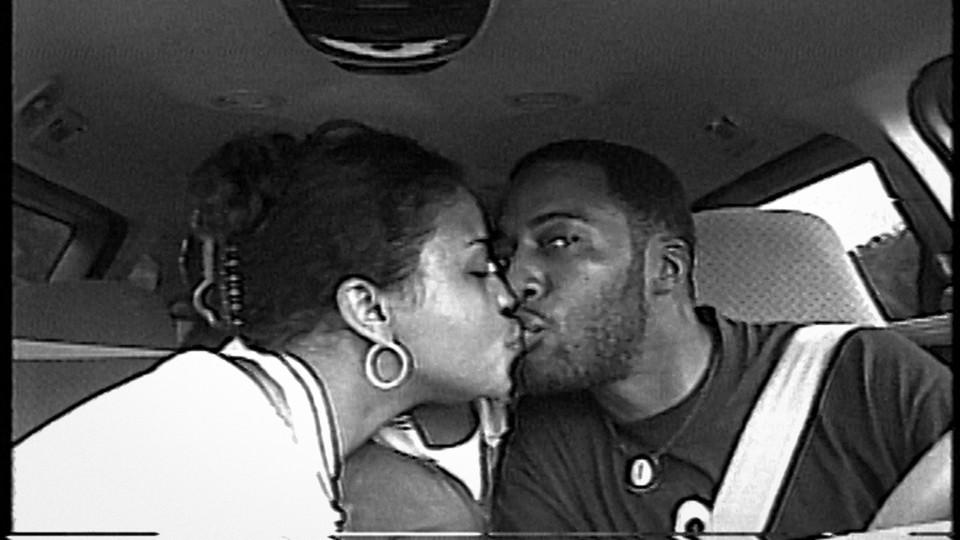 Rob and Sibil (Fox) Richardson share a kiss 20 years ago.