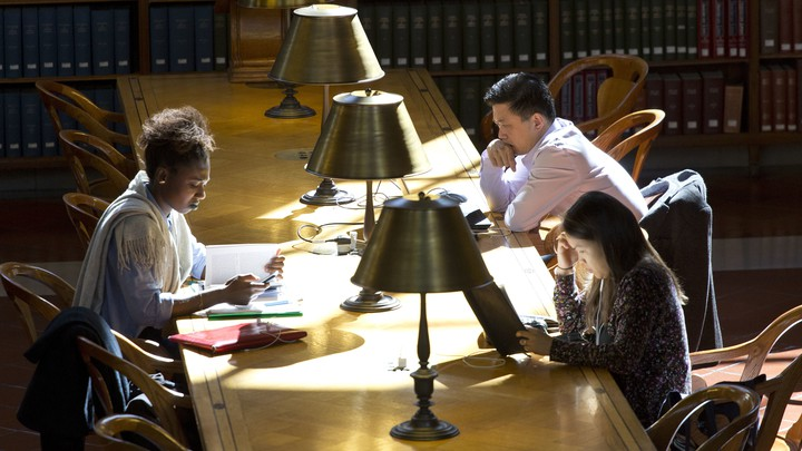 People read in the Rose Main Reading Room of the New York Public Library
