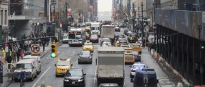Cars, taxis, buses, and pedestrians on Manhattan's 42nd Street.