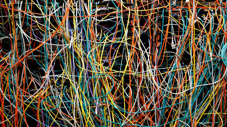 A tangle of colorful computer wires