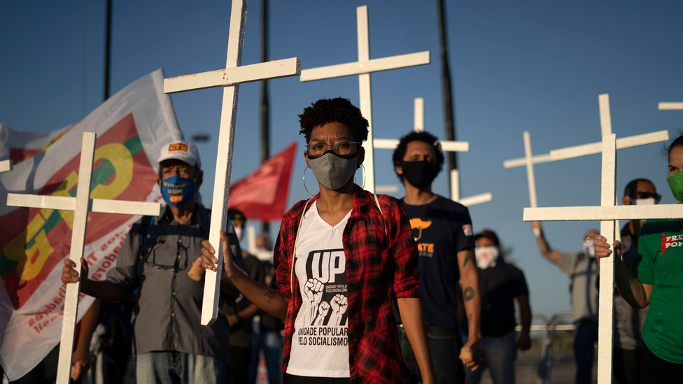 Crowd holding crosses at a protest