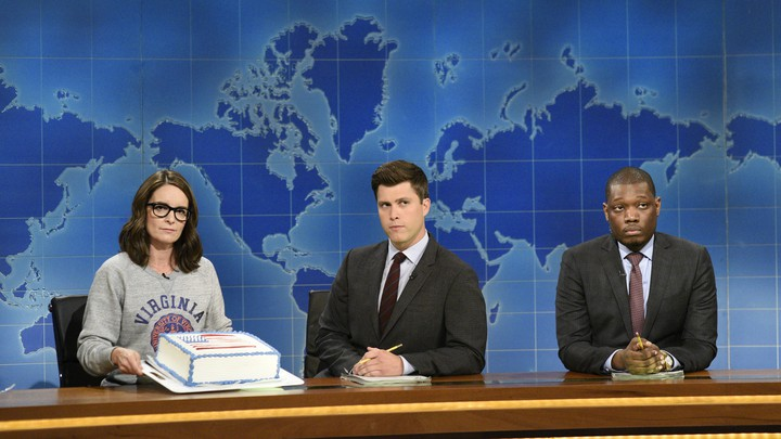 Tina Fey, Colin Jost, and Michael Che during 'Weekend Update: Summer Edition'