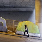 a photo of tents beneath a highway overpass in Seattle, WA