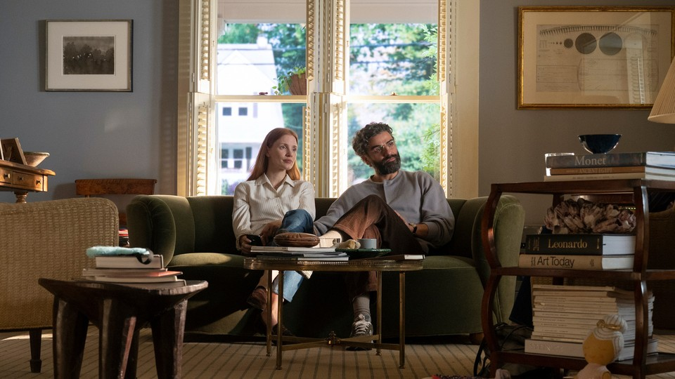 """Jessica Chastain and Oscar Isaac sit on a couch in """"Scenes From a Marriage."""""""