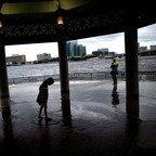 A little girl surveys the high water levels in Jacksonville after Hurricane Irma recedes.