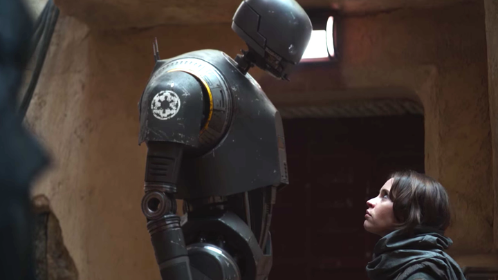 The droid K-2SO stares down Felicity Jones's character Jyn Erson in the 'Rogue One' trailer.