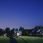 A miniature suburban street at dusk.