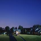 A miniature suburban street at dusk.