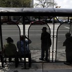 Passengers wait at a New Jersey bus stop.