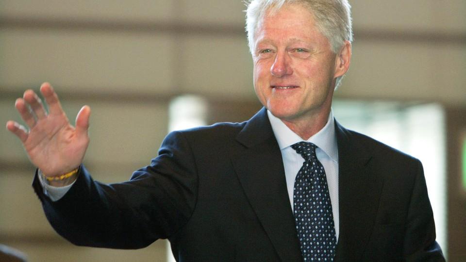 President Clinton waves