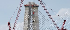 Construction cranes work on towers of a portion of a new cable-stayed bridge, a public project that is being built to replace the Governor Malcolm Wilson Tappan Zee Bridge across the Hudson River.