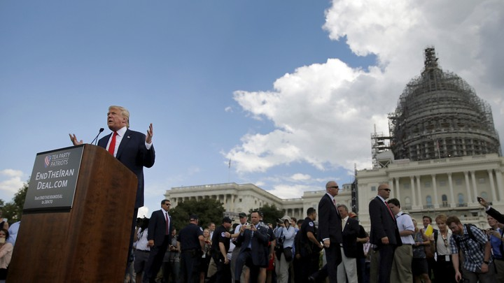 Donald Trump addresses a Tea Party rally against the Iran nuclear deal at the U.S. Capitol.