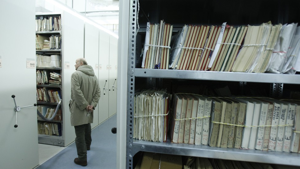 A visitor looks at a shelf containing documents during a public day at the Federal Department for the Stasi Records in Berlin.