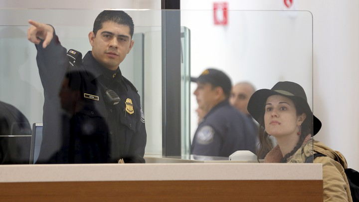 A traveler is directed as she passes through U.S. Customs and Immigration.