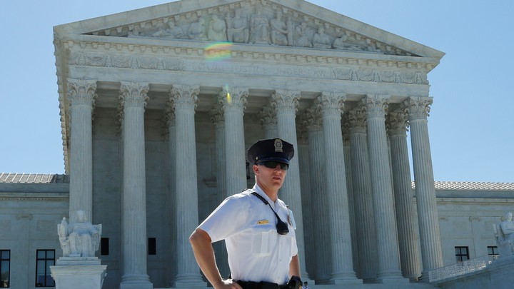 A police officer stands outside the U.S. Supreme Court building
