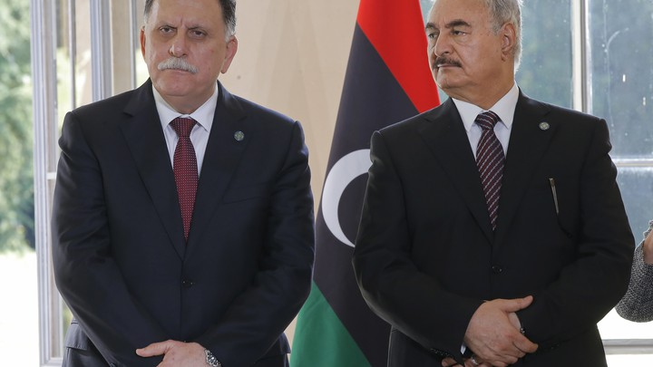 Libyan Prime Minister Fayez al-Sarraj and General Khalifa Haftar declare a ceasefire on July 25, 2017.