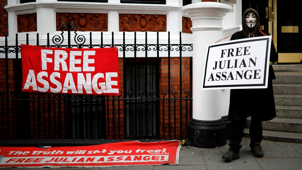 A person demonstrates in front of Ecuador's embassy in London, where Julian Assange was staying until his arrest.