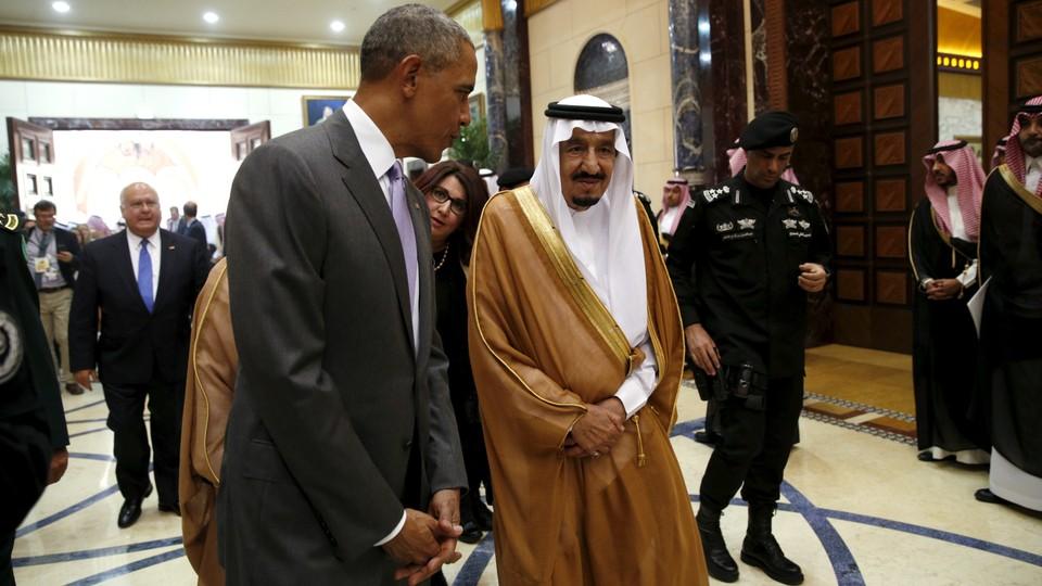 President Barack Obama walks with Saudi King Salman.