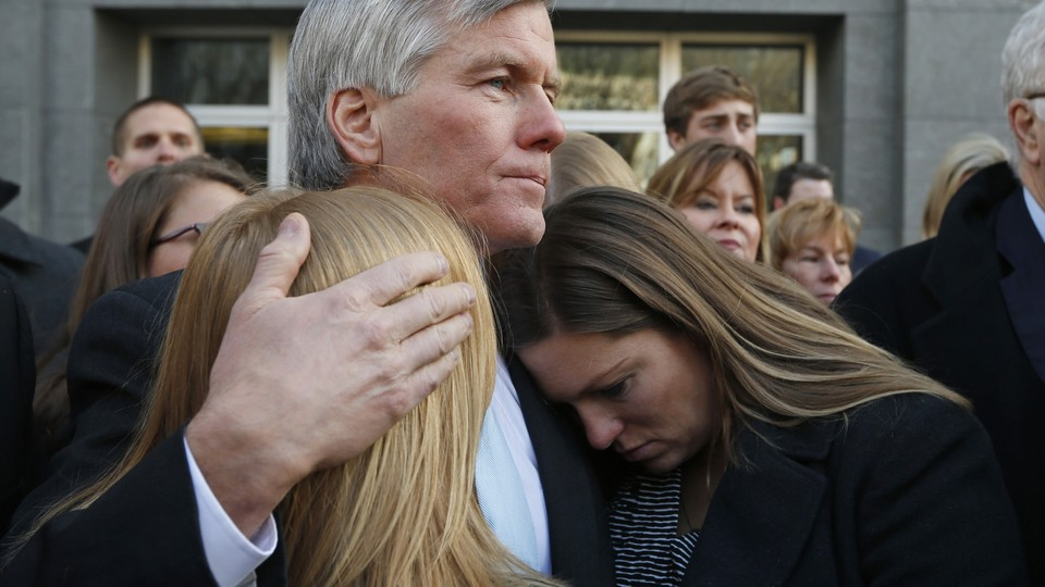 In this Tuesday, Jan. 6, 2015, file photo, former Virginia Gov. Bob McDonnell, center, hugs his daughters Cailin Young, left, and Jeanine McDonnell Zubowsky, right, after speaking outside federal court in Richmond, Va. McDonnell was sentenced to two years prison and two years probation in his corruption case.