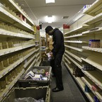 A worker stocks shelves at a temporary CVS store in the Rockaway Beach neighborhood of Queens, New York. CVS has set up a temporary store in the parking lot of a CVS location that had been damaged in Hurricane Sandy.