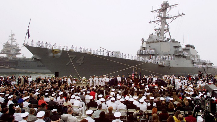 Bill Clinton speaks at a memorial service for the victims of the USS Cole bombing in October 2000.