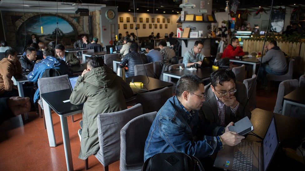 People sitting in Garage Cafe in Beijing, a meet-up space for investors and entrepreneurs