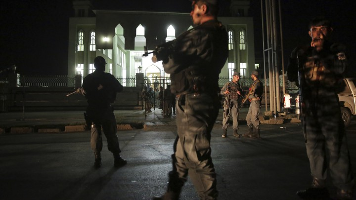 Security forces respond at the site of the attack on the al-Zahra mosque in Kabul, Afghanistan on June 15, 2017.