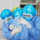 Health workers hugging in Zouping, China