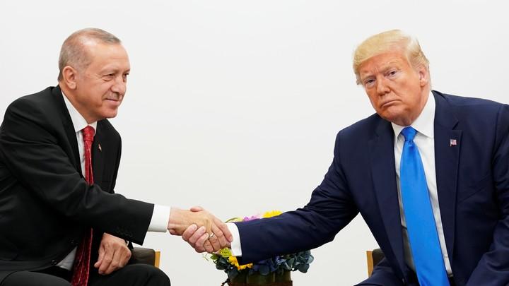 President Donald Trump and President Recep Tayyip Erdoğan shake hands.
