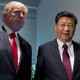 President Donald Trump and Chinese President Xi Jinping stand side by side.