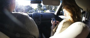 Passengers in a ride-hailing vehicle.