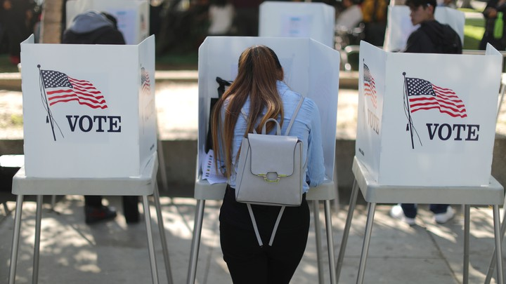 A young woman votes.