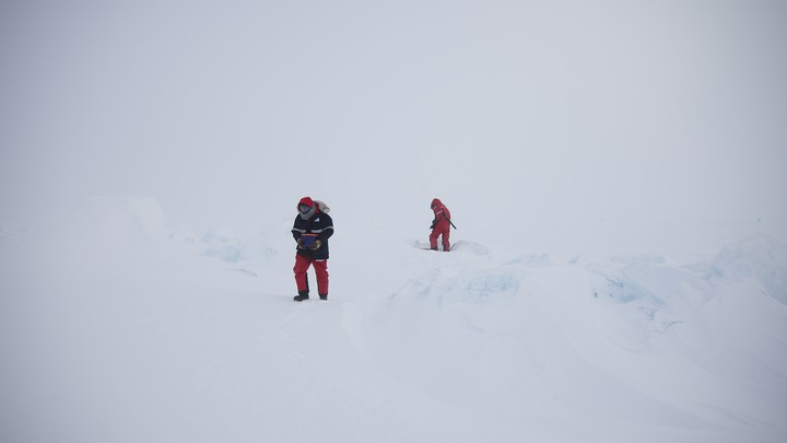 Alexey Niubom (right) doing a battery exchange in the field in early April