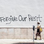 "photo: a wall tagged with ""Forgive Our Rent"" graffiti"