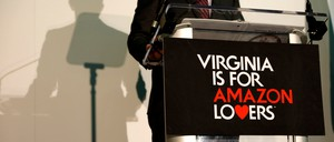 """A """"Virginia is for Amazon Lovers"""" sign at an HQ2 press conference"""