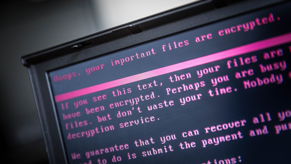 A laptop displays a message after being infected by a ransomware as part of a worldwide cyberattack on June 27, 2017.