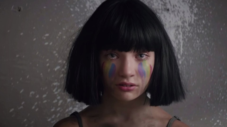 """Maddie Ziegler wears rainbow makeup in the video for """"The Greatest"""""""