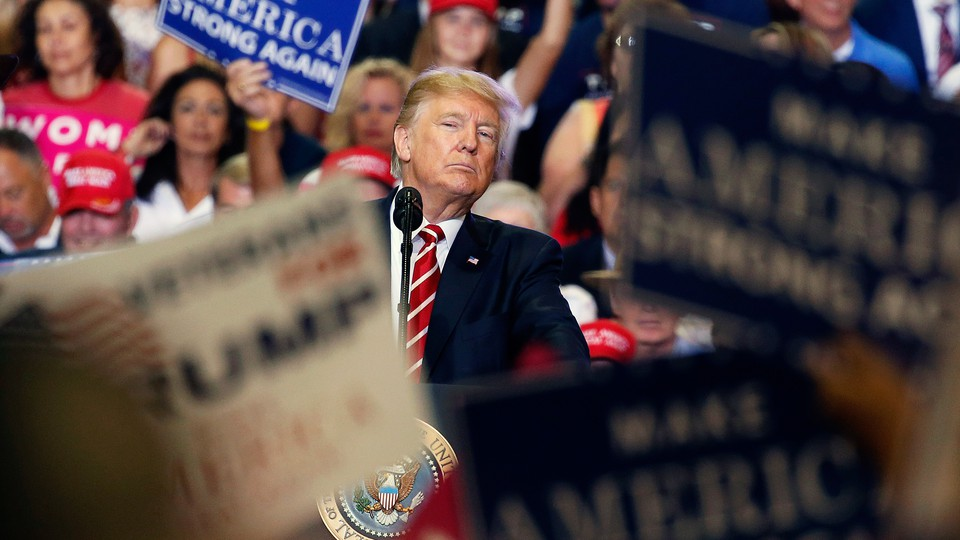 The president peers into the crowd at a campaign rally in August in Arizona.