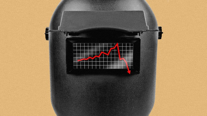 An image of a welding mask with a downward trending graph on top.