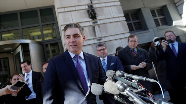 Jim Acosta talks to reporters after a judge temporarily restored his White House press credentials.